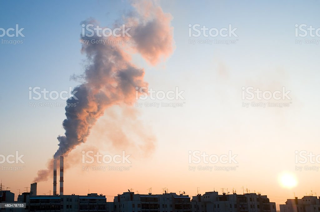 Smokestacks at dawn stock photo