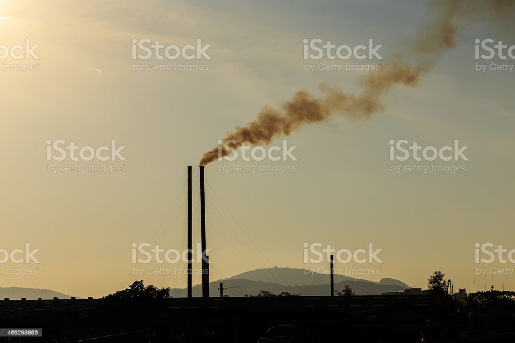 Smokestacks at sunset time stock photo