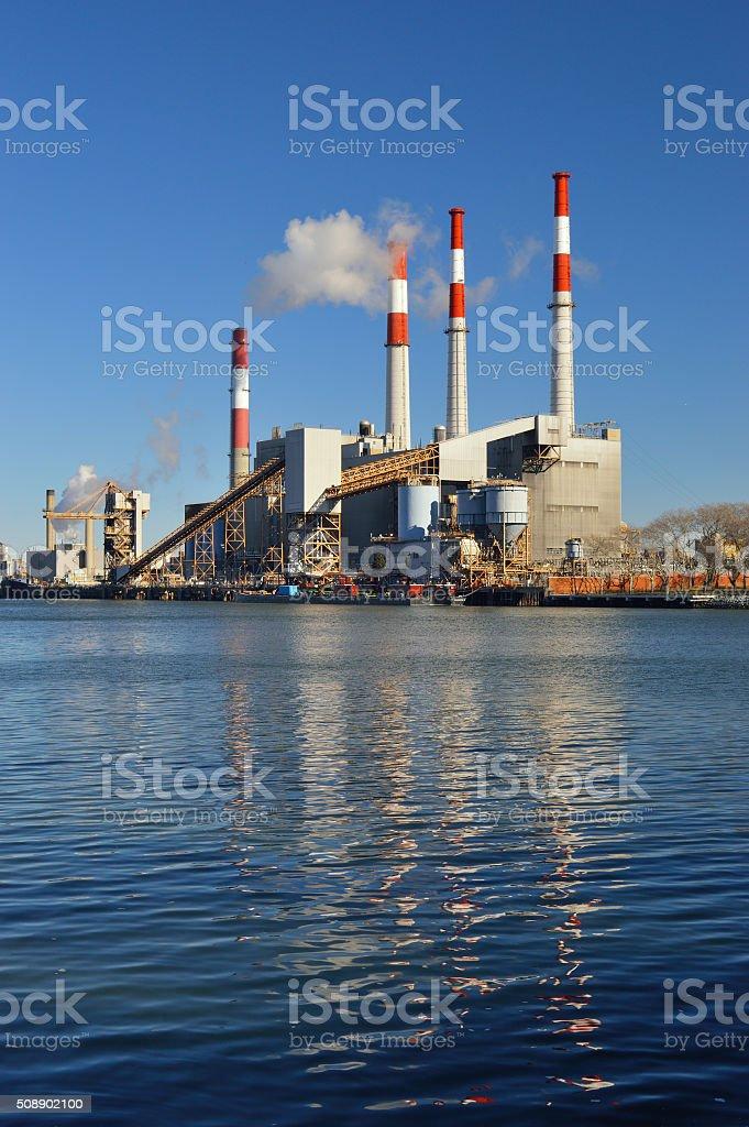 Smokestacks over a Ravenswood Generating Station. stock photo