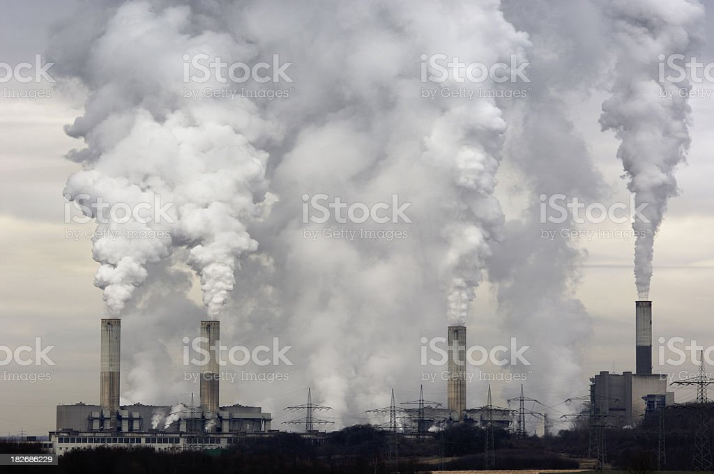 Smokestacks with pollution royalty-free stock photo