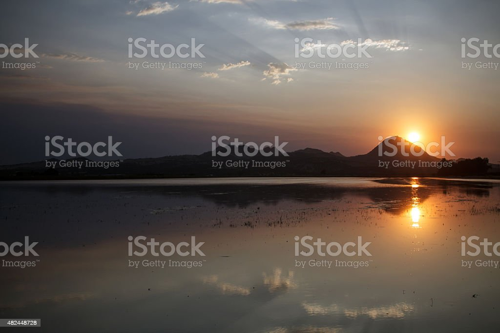 Smokey sunset over Sutter Buttes in Northern California stock photo
