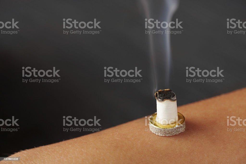 Smokig mini moxa stick stock photo