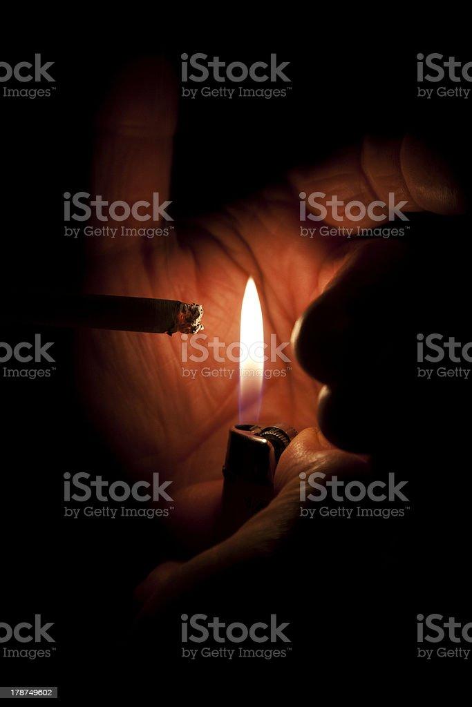 Smoking a cigarette stock photo