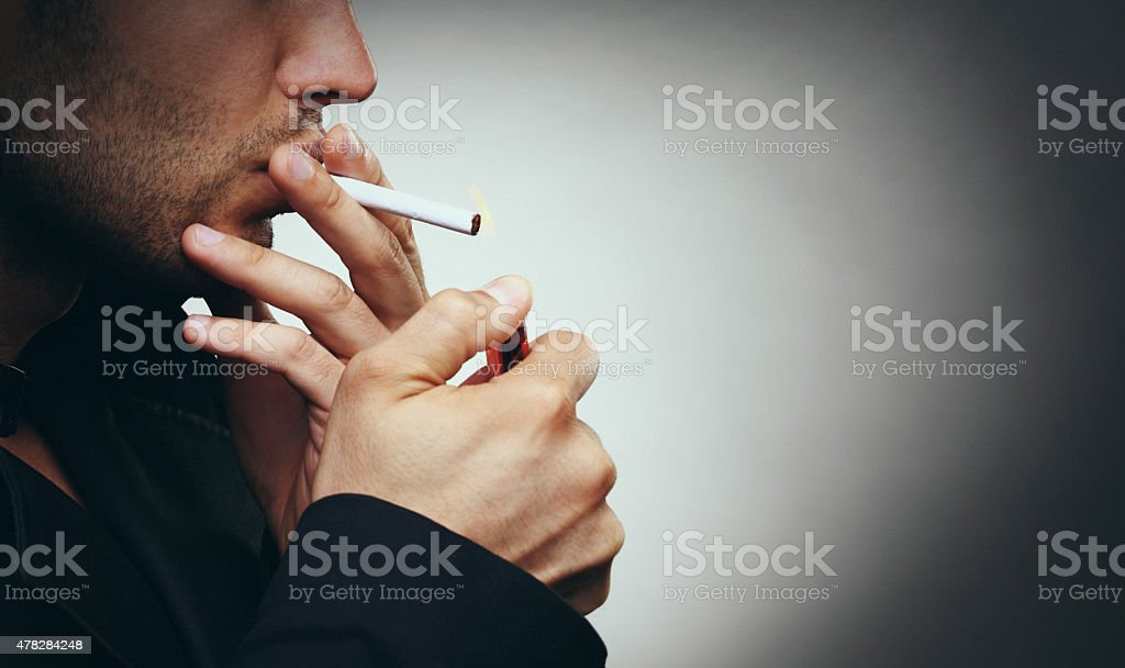 Smoking a cigarette. stock photo