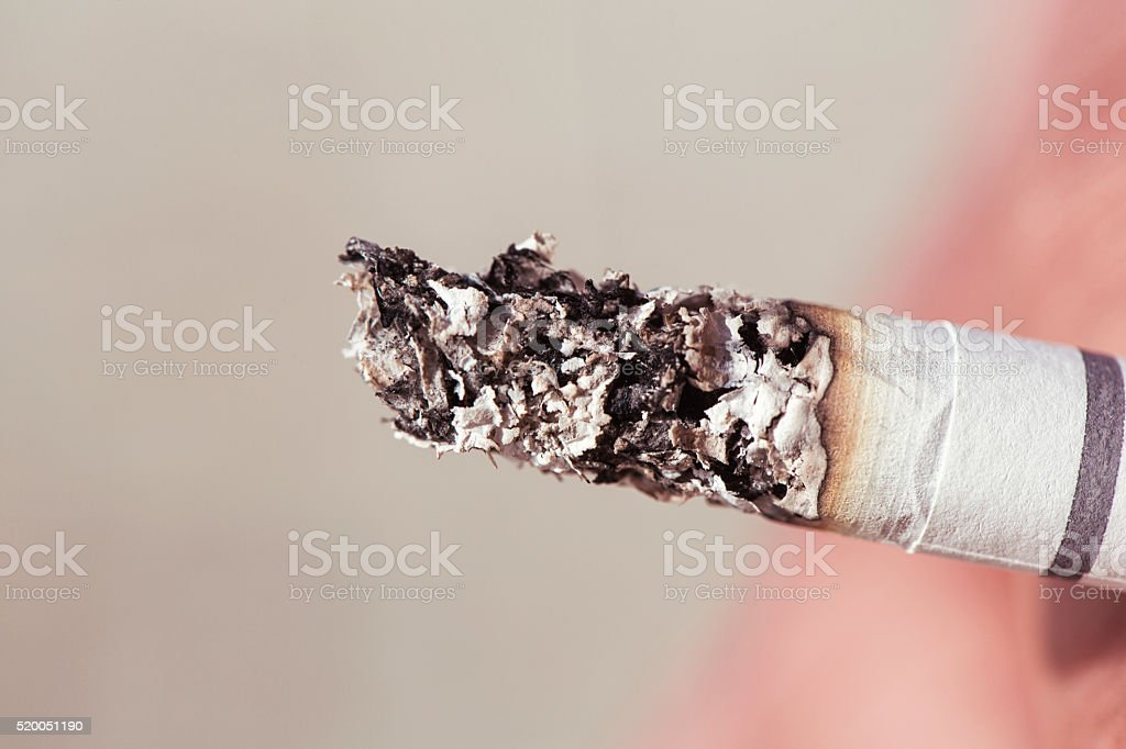 Smoking and cigarette ash stock photo