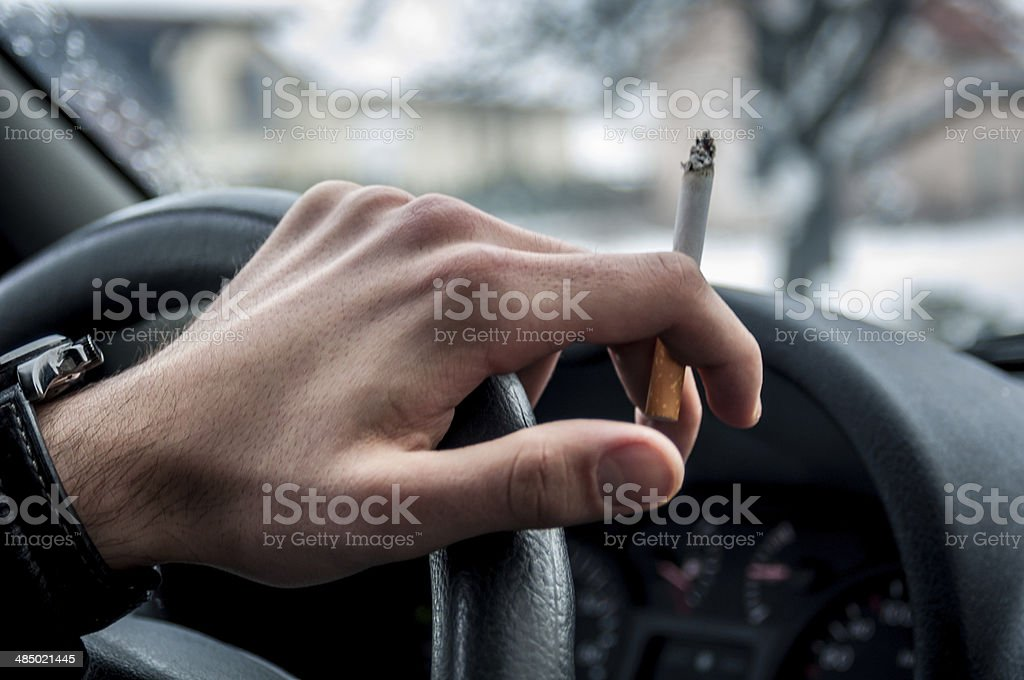 Smoking and driving stock photo