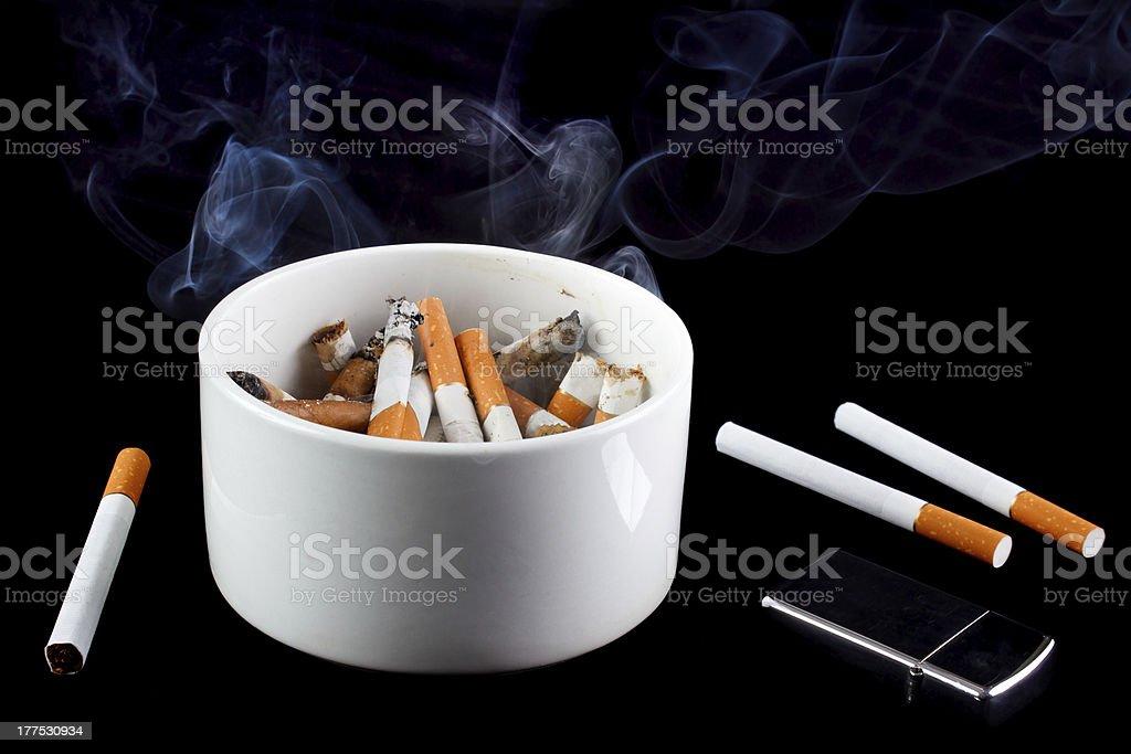 Smoking ashtray royalty-free stock photo