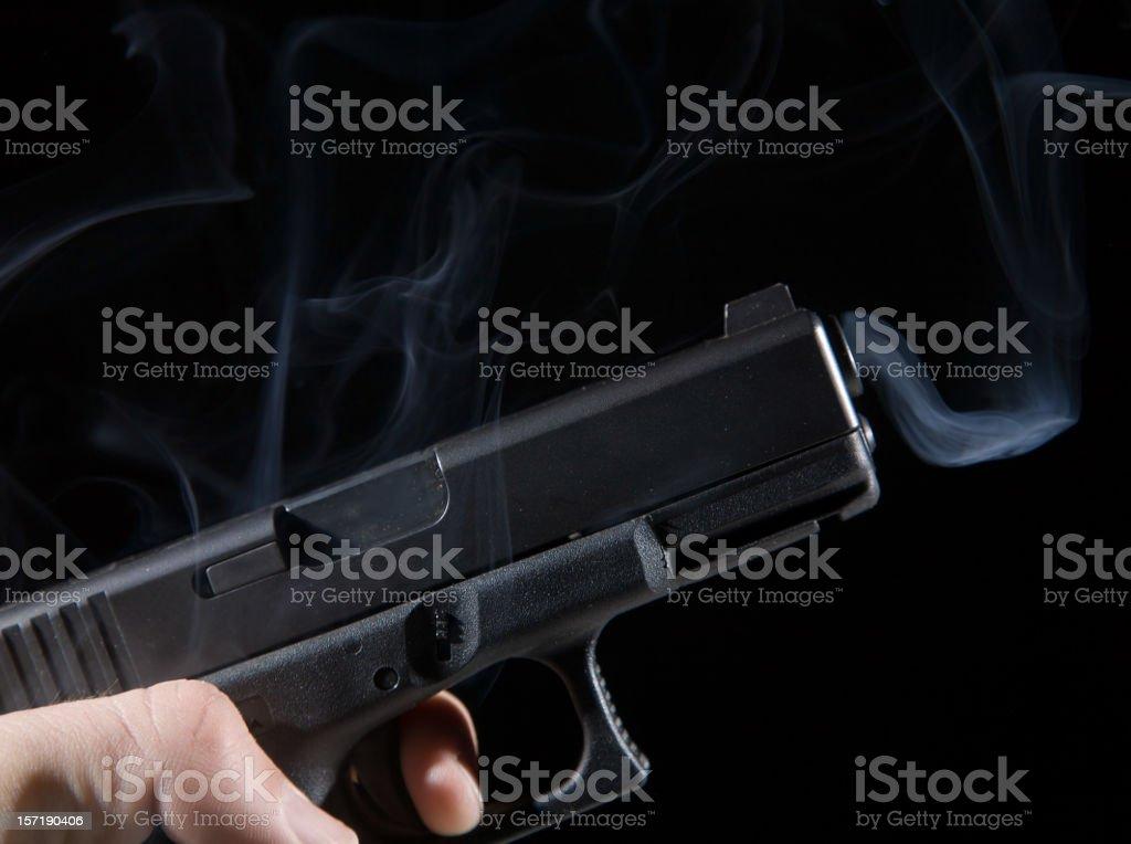 Smoking Black Gun royalty-free stock photo