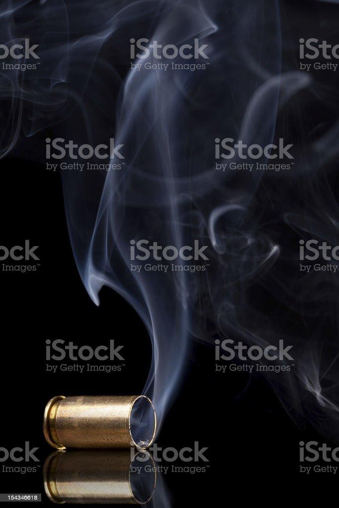 Smoking bullet casing stock photo