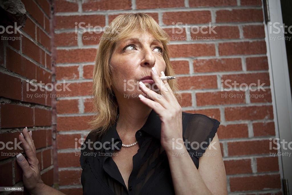 Smoking businesswoman stock photo