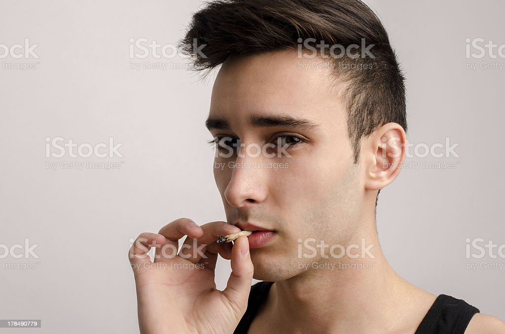 Smoking can be sexy and dangerous. stock photo