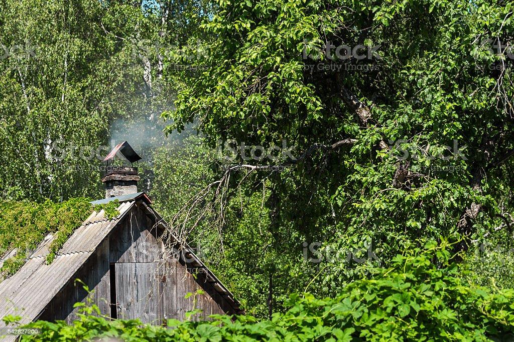 Smoking chimney in summer stock photo