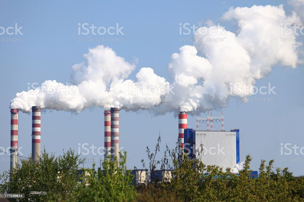 smoking chimneys from a power plant royalty-free stock photo