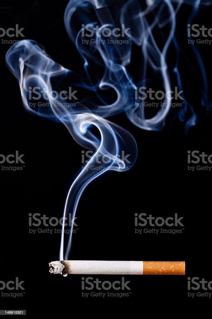 Smoking cigarette. Isolated on black. stock photo