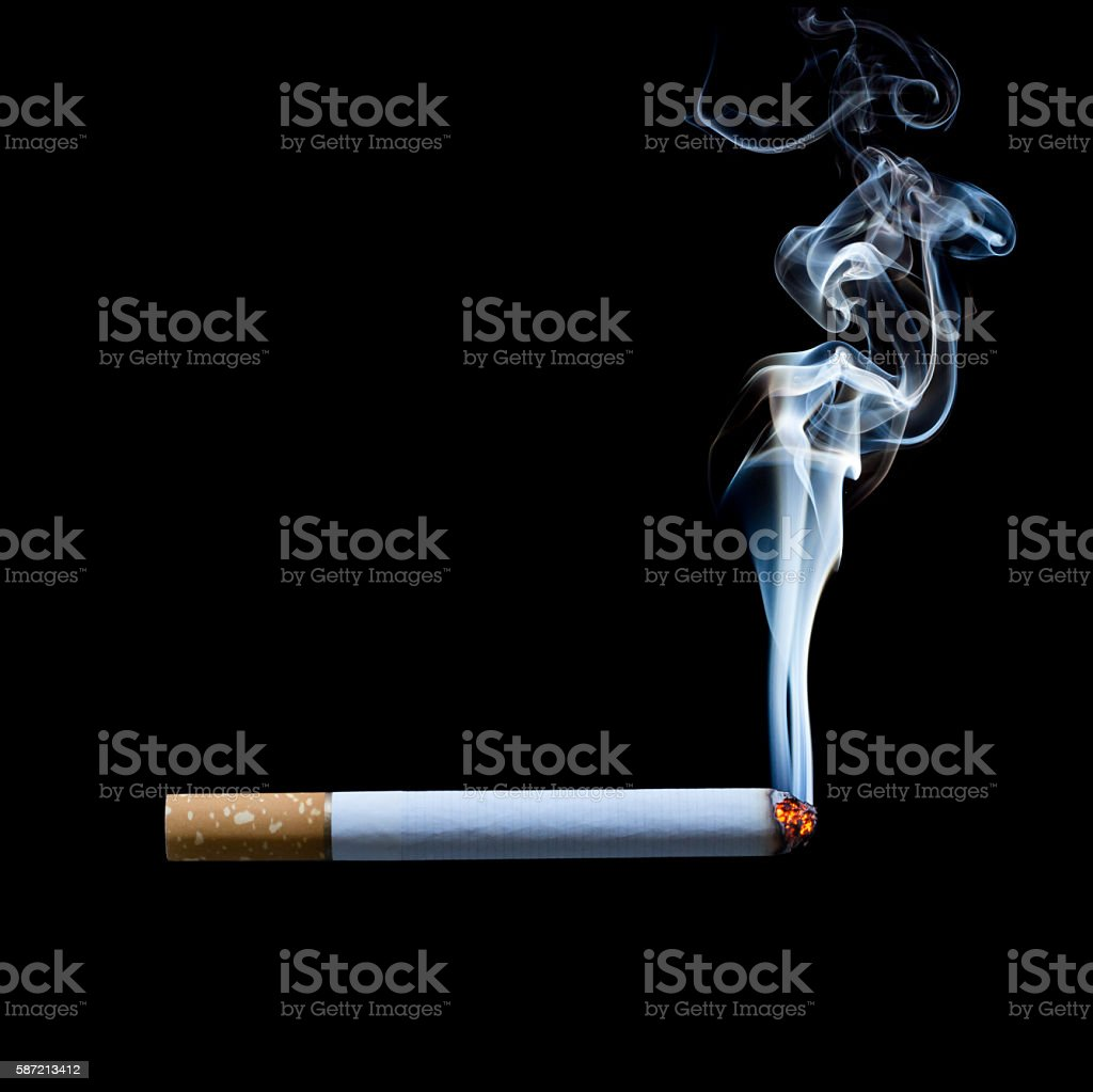 smoking cigarette on black background stock photo