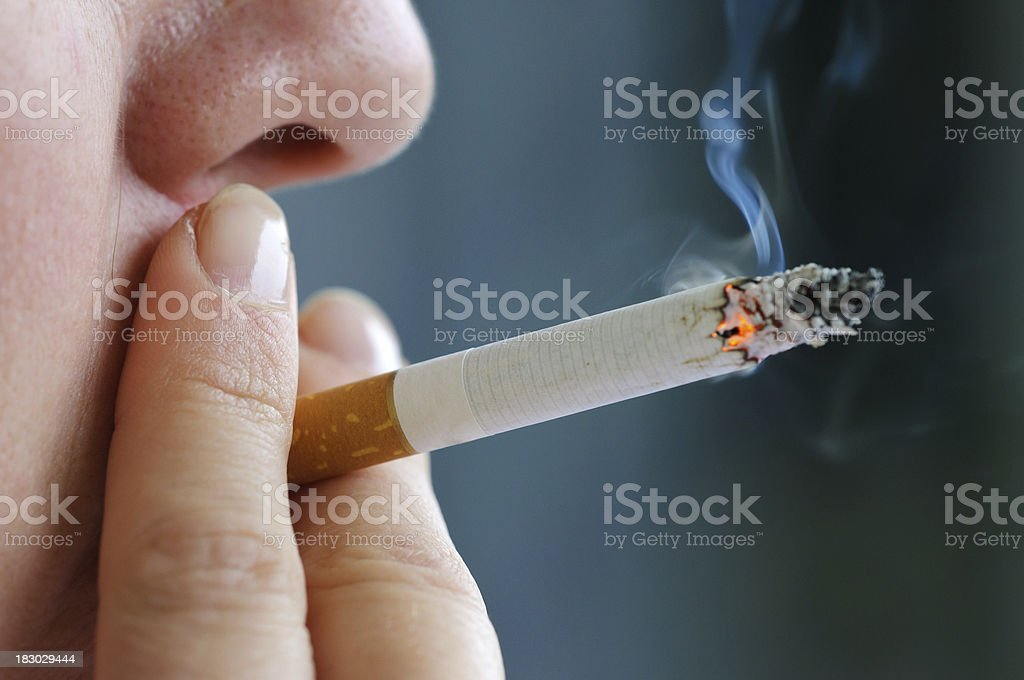 Smoking cigarette stock photo