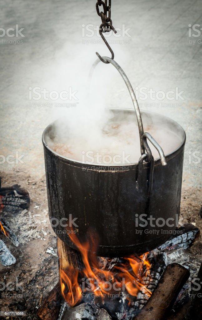 Smoking cooking pan boiling outdoors stock photo