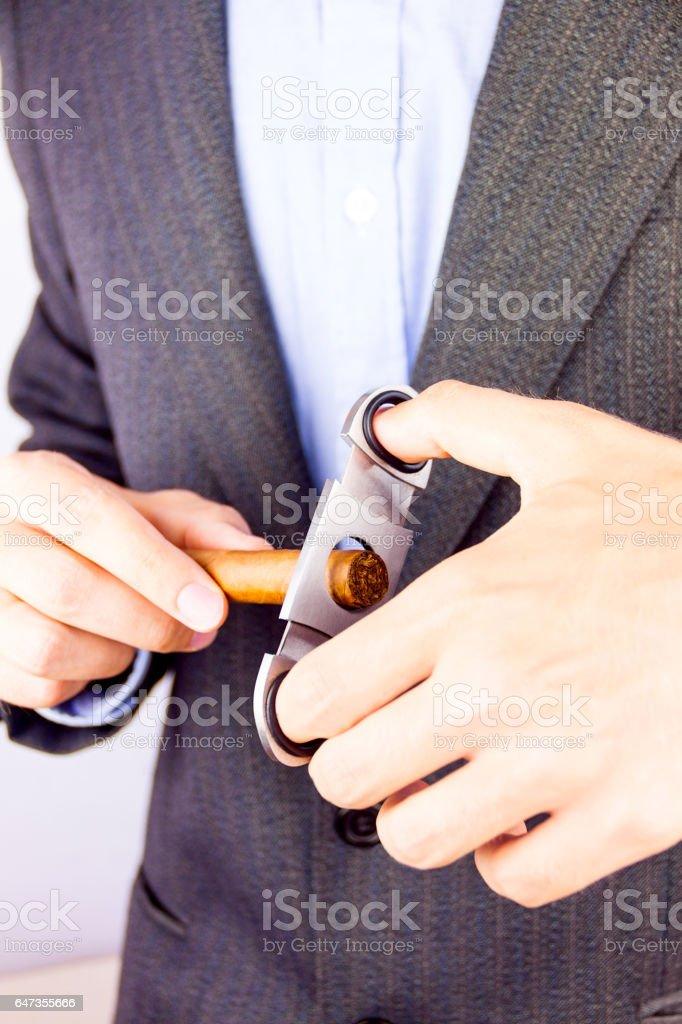 Smoking Cuban cigar stock photo