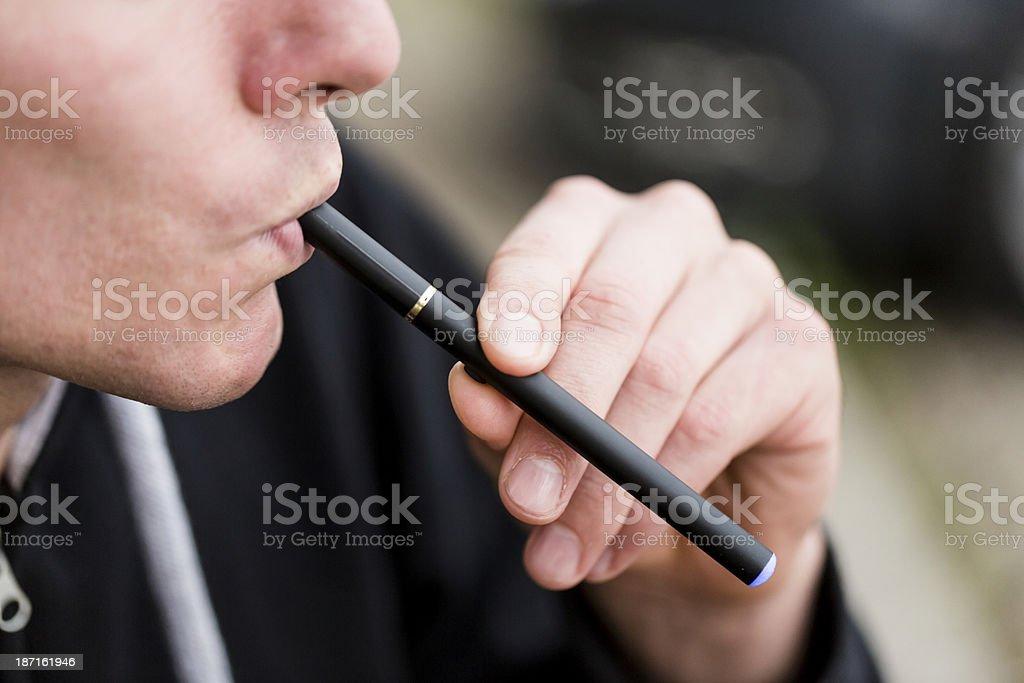 Smoking E-Cigarette royalty-free stock photo