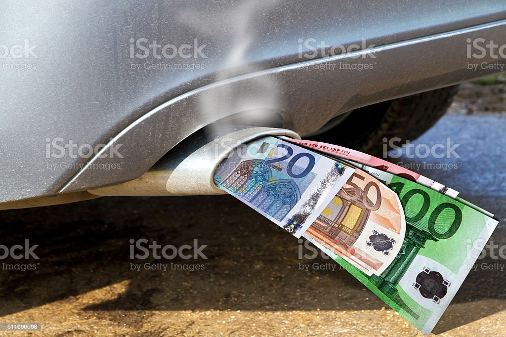 Smoking exhaust pipe with money stock photo