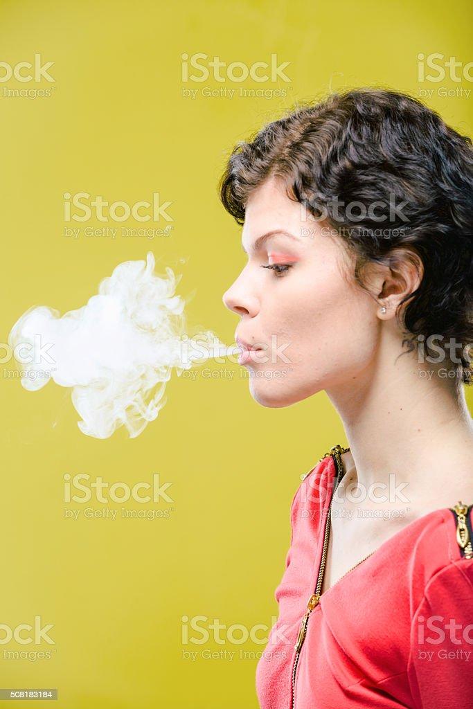 Smoking girl with steam stock photo