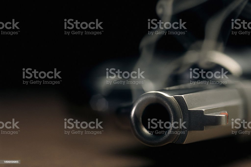Smoking gun lying on the floor, revolver stock photo
