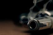 Smoking gun lying on the floor, revolver