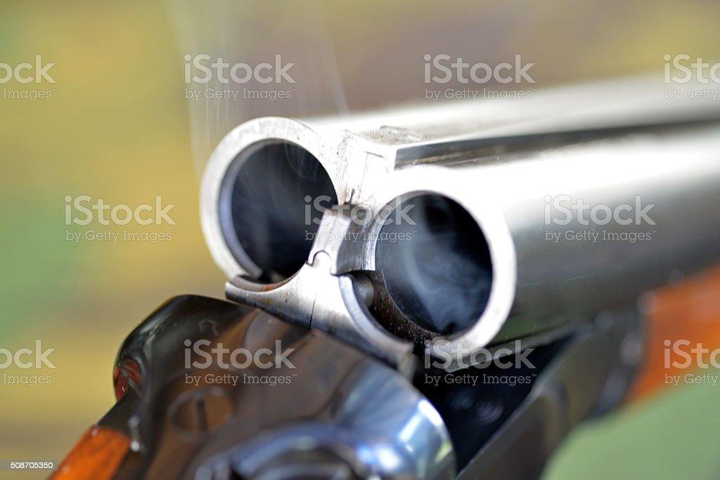 Smoking gun. stock photo