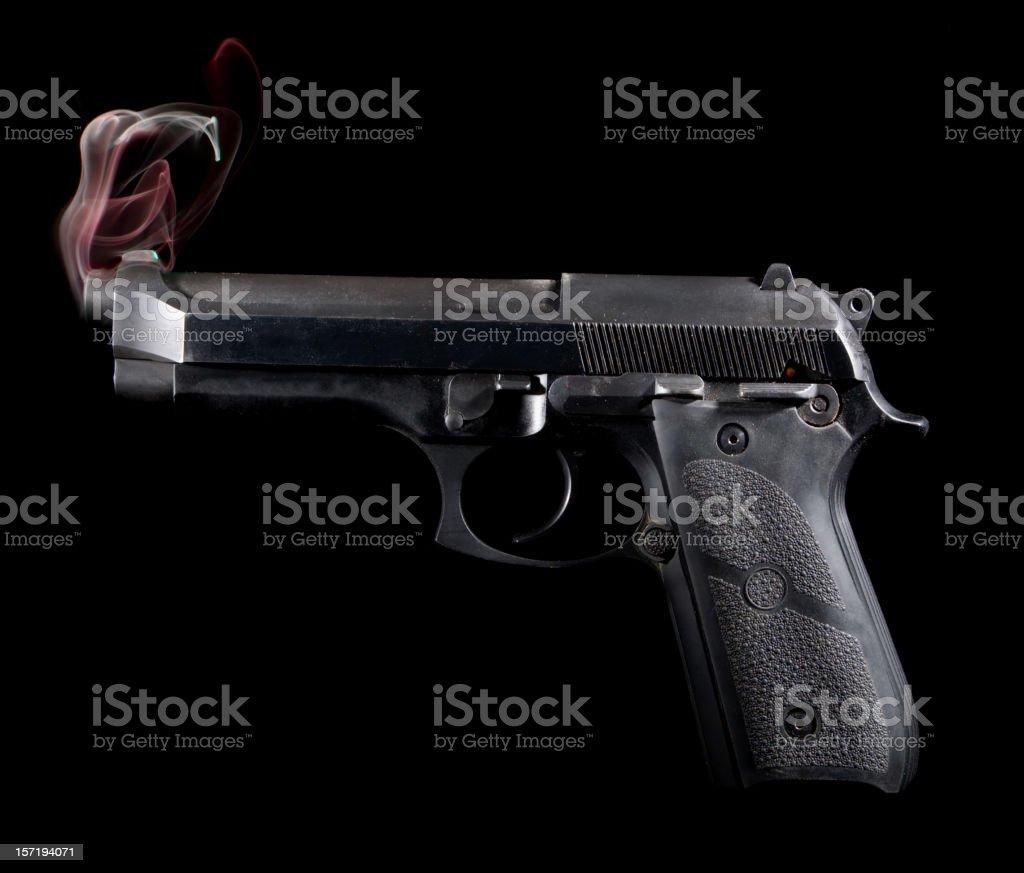 Smoking Gun - Red Smoke stock photo