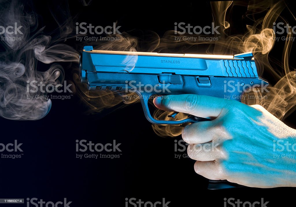 Smoking Gun - Semi Automatic Pistol stock photo