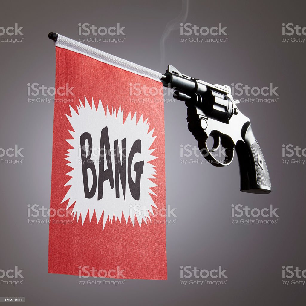 Smoking gun shooting a flag with a bang message stock photo