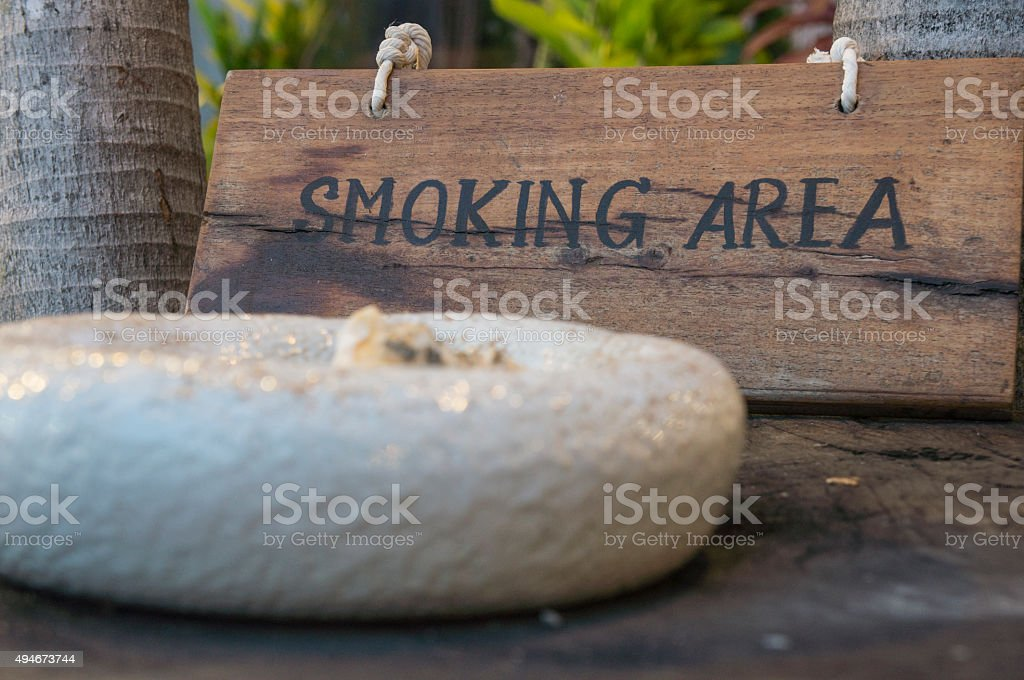 smoking here sign wooden wood tobacco public concept stock photo