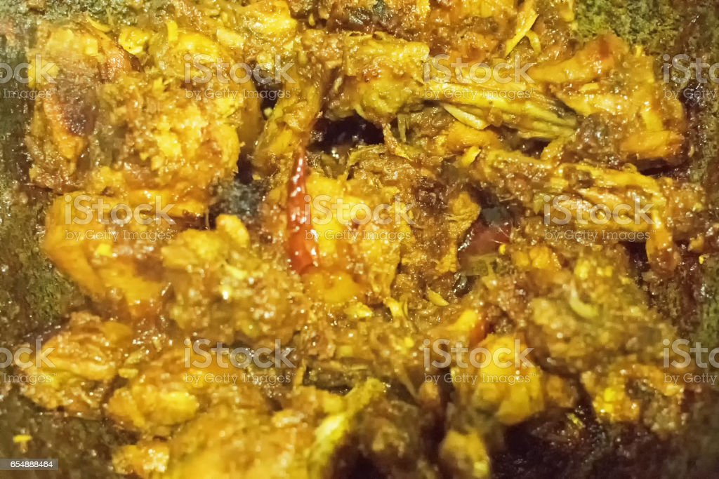 smoking hot Indian chicken curry being made stock photo