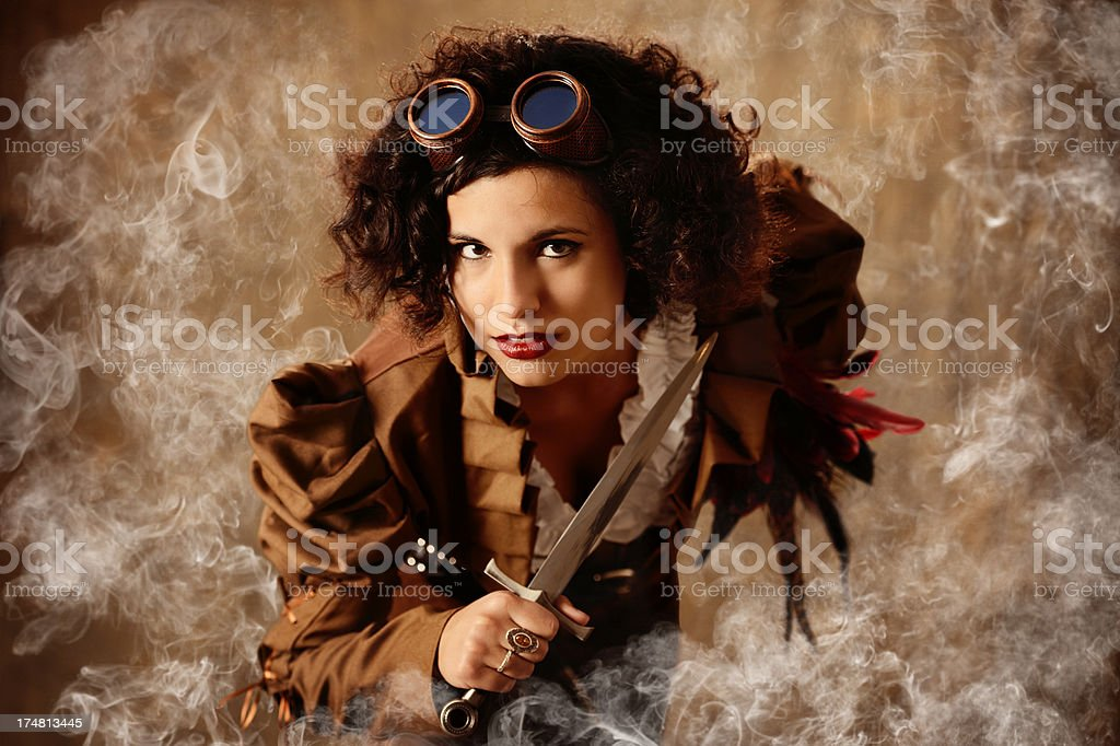 Smoking Hot Steampunk Pirate Queen With Knife and Goggles stock photo
