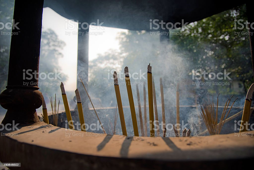 Smoking incenses in a shrine stock photo