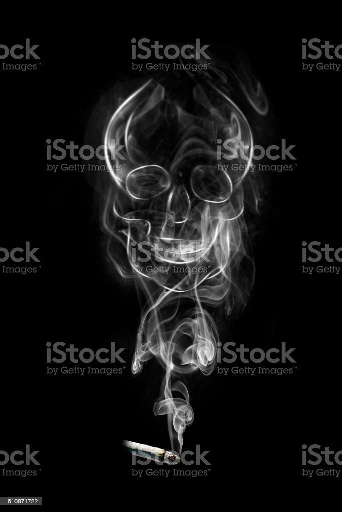 Smoking kills skull stock photo