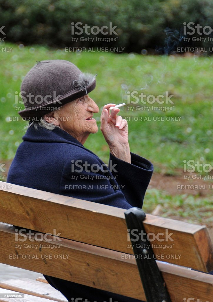 Smoking Lady on the Bench stock photo