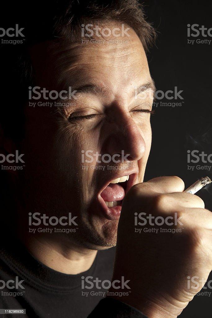 Smoking man coughing royalty-free stock photo