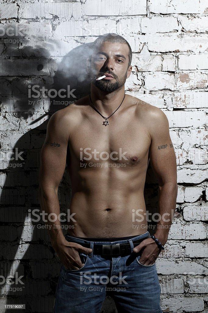 Smoking man stock photo