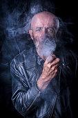 Smoking man portrait in low key