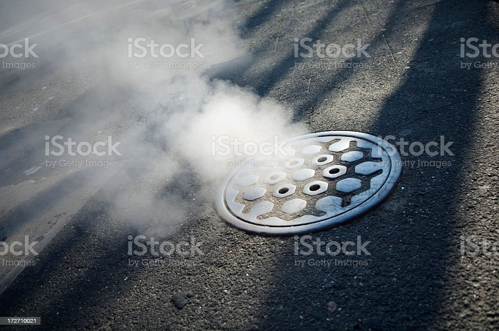 Smoking manhole cover in  new York City stock photo