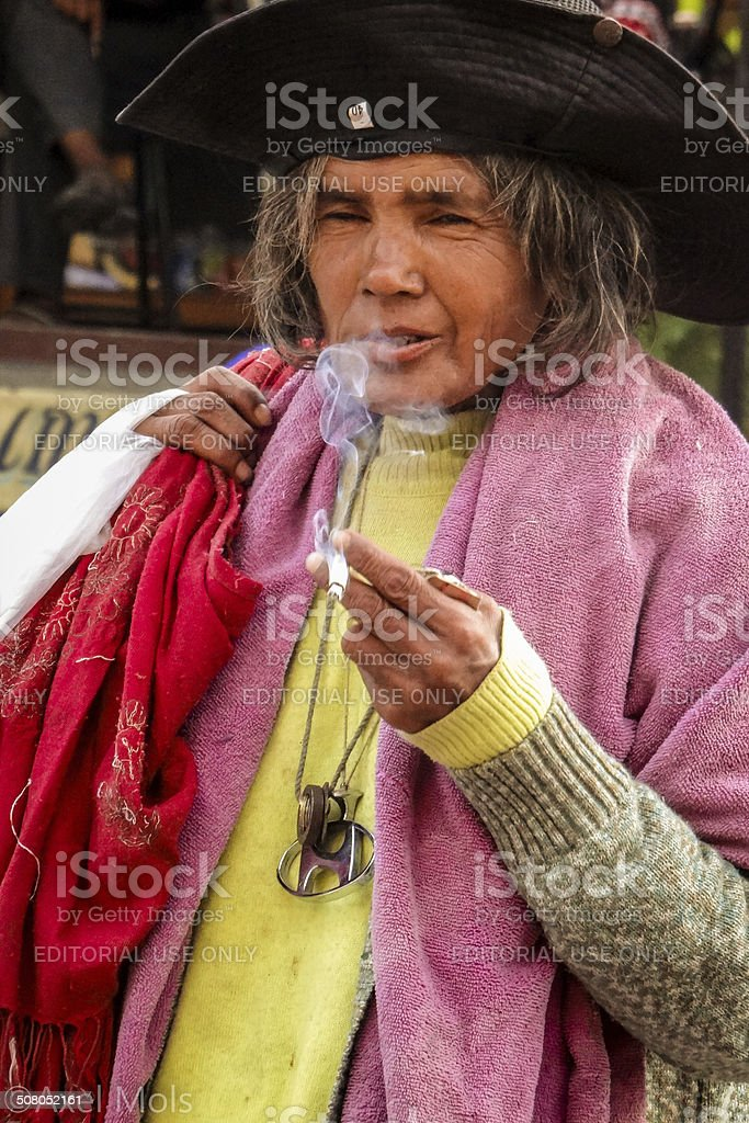 Smoking Nepalese Old Lady stock photo