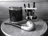 Smoking pipe with tobacco stand