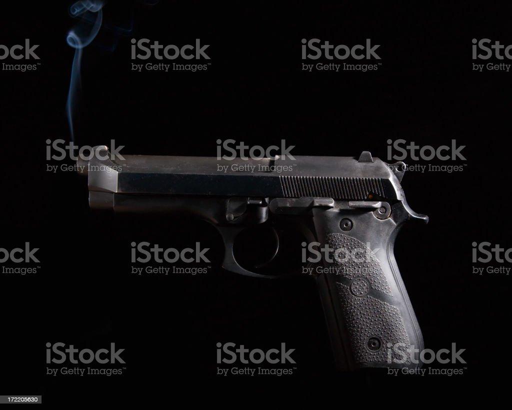 Smoking Pistol stock photo