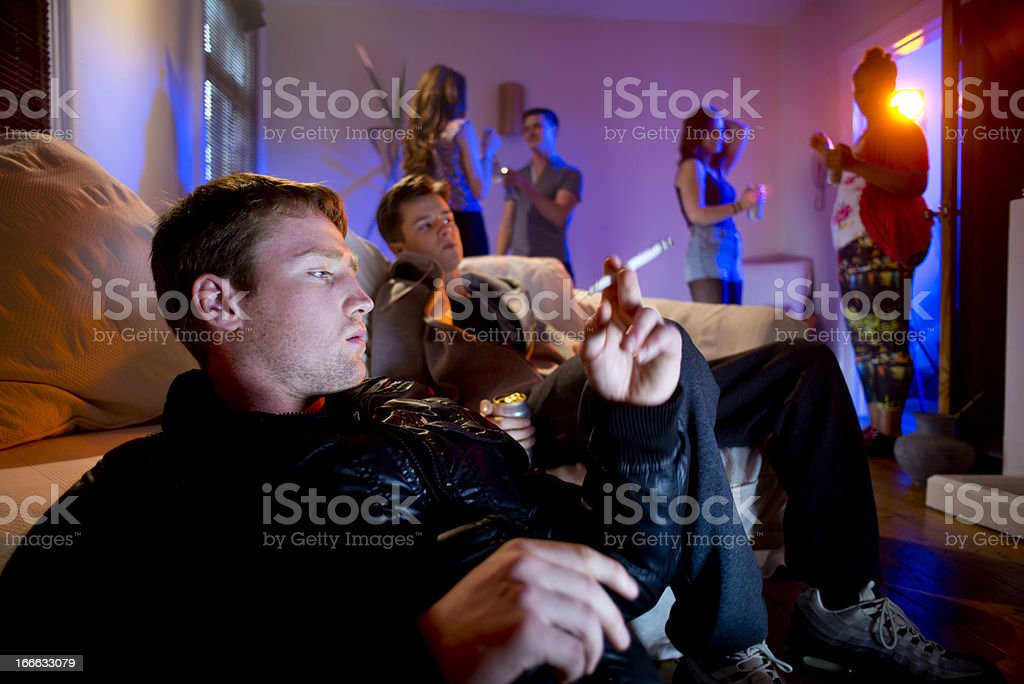 smoking pot at a house party royalty-free stock photo