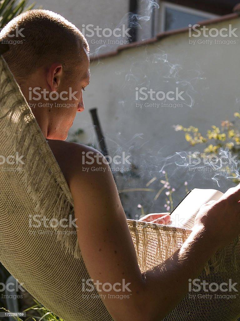 Smoking & Reading royalty-free stock photo