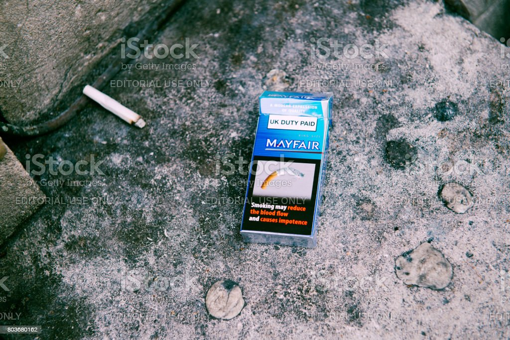 Smoking seriously harms you and others around you cigarette pack stock photo