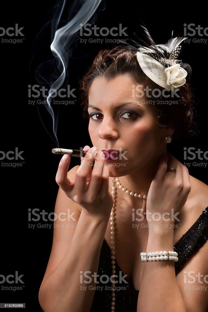 Smoking vintage lady stock photo