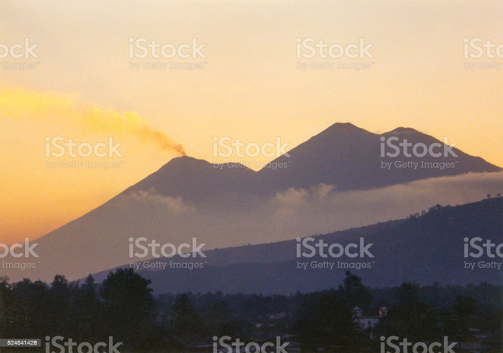 Smoking volcano twilight stock photo