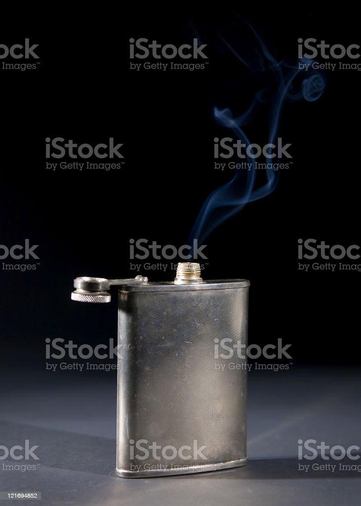 Smoking Whiskey Flask stock photo